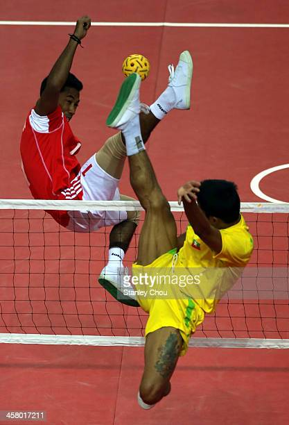 Yudi Pornomo of Indonesia battles with Alung Pyah Tun of Burma during the Men's Team Double Final of the Sepak Takraw Competition during the 2013 SEA...