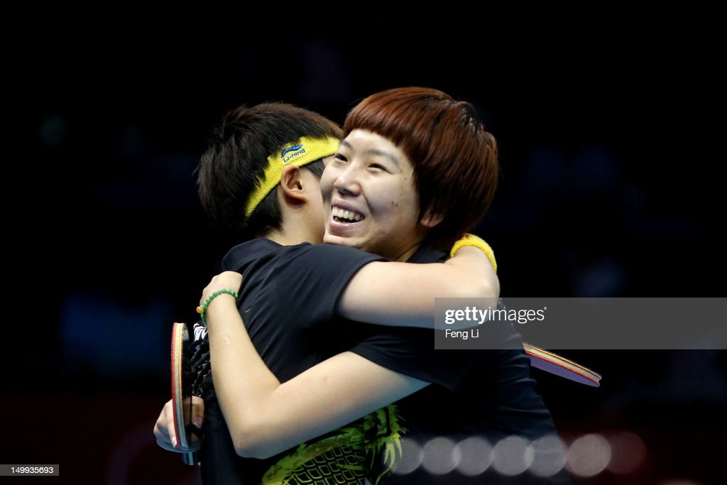 Yue Guo (L) and Xiaoxia Li (R)of China celebrate their 3-1 victory against Kasumi Ishikawa and Sayaka Hirano of Japan and winning the Women's Team Table Tennis gold medal match on Day 11 of the London 2012 Olympic Games at ExCeL on August 7, 2012 in London, England.