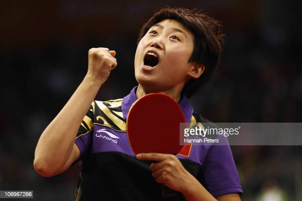 Yue Guo of China celebrates winning the Women's Doubles Final with Xiaoxia Li of China against Ning Ding and Shiwen Liu of China at Guangzhou...
