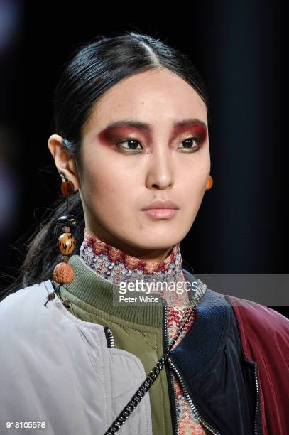 Yue Han walks the runway at the Vivienne Tam show during New York Fashion Week at Gallery I at Spring Studios on February 13 2018 in New York City