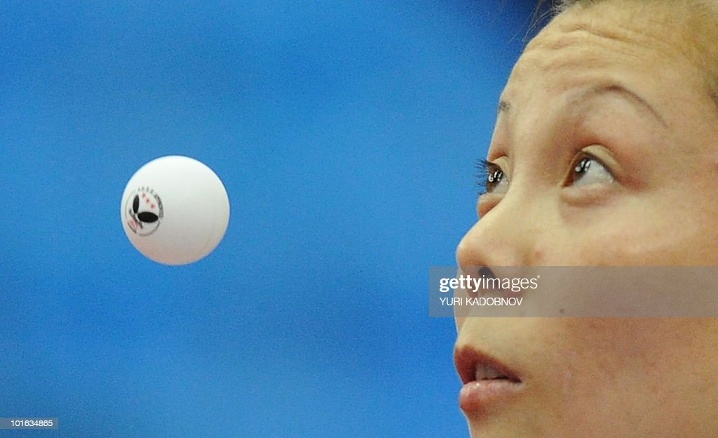 Yuegu Wang of Singapore returns a service to Kristin Silbereisen of Germany during the women's semi final at the 2010 World Team Table Tennis Championships in Moscow on May 29, 2010.