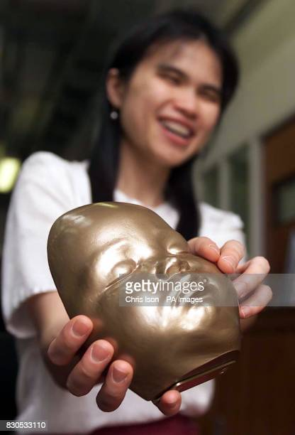 Yuen Har Tse with a model of her son Christopher's face aged 7 months Engineers at Exeter University's Advanced Technologies Dept made the polymer...