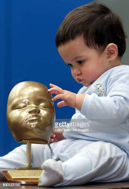 Yuen Har Tse's son Christopher with a model of his face aged 7 months Engineers at Exeter University's Advanced Technologies Dept made the polymer...