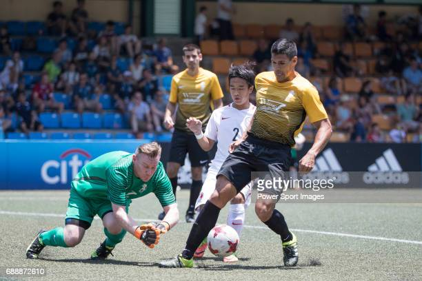 Yuen Ho Chun saving a ball from scoring from Singapore Cricket Club's Tim Walter during their Main Tournament match part of the HKFC Citi Soccer...