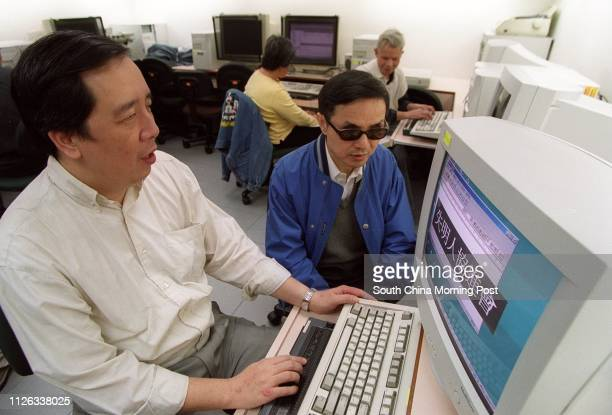Yuen Kin-ming , Executive Committee Member of the Hong Kong Blind Union, and Kevin Chow Kin-chun, Consultation Group Chairman, operating a computer...