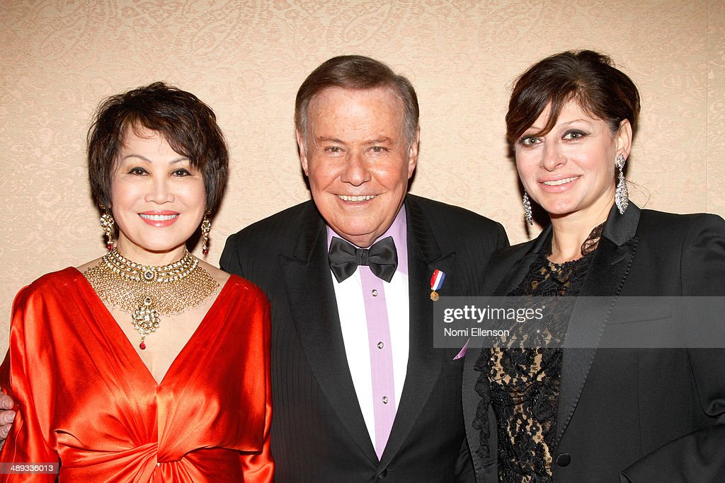 Yue-Sai Kan, Marvin Scott, and Maria Bartiromo attend the 2014 Ellis Island Medals Of Honor at Ellis Island on May 10, 2014 in New York City.