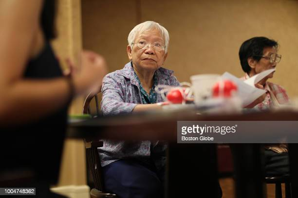 Yuet Fong Hom listens to the presentation during a 'Heart to Heart Cafe' at the Kenmore Abbey Apartments in Boston on July 18 2018 Boston Senior Home...
