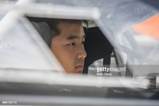Yufeng Luo prepares to drive before the Pirelli World Challenge GT race at the Grand Prix at Long Beach on April 9 2017 in Long Beach California