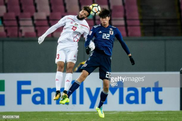 Yugo Tatsuta of Japan and Shehab Qumbor of Palestine compete for the ball during the AFC U23 Championship Group B match between Japan and Palestine...