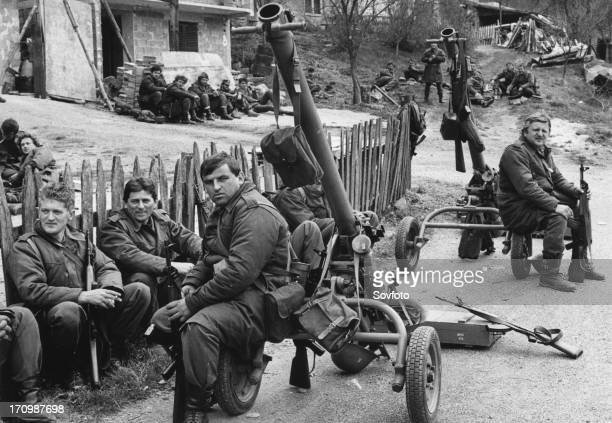 Yugoslav army reservists resting before entering bosnian town of visegrad 170 km south of belgrade war yugoslavia
