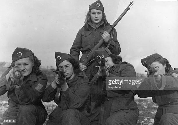Yugoslav fighters members of the patriot forces led by Marshal Josip Broz called Tito shoot at practice targets while resting at an Allied camp in...