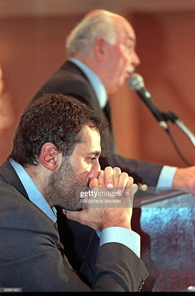 Yugoslav NBA player Vlade Divac (foreground) holds : News Photo