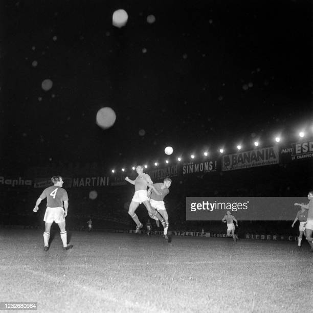 Yugoslav player and a Soviet player jump for the ball during the final of the first-ever UEFA European Nations' Cup tournament at Parc des Princes,...