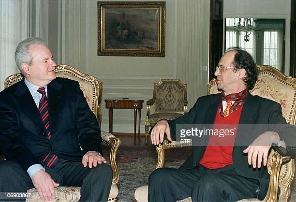 Yugoslav President Slobodan Milosevic listens to ethnic Albanian leader Ibrahim Rugova during talks in Yugoslav capital of Belgrade April 1 Yugoslav...