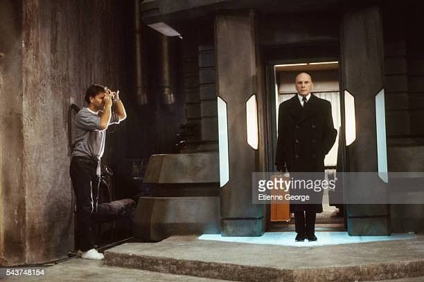 Yugoslavborn director and cartoonist Enki Bilal with actor JeanLouis Trintignant on the set of his film Bunker Palace Hotel