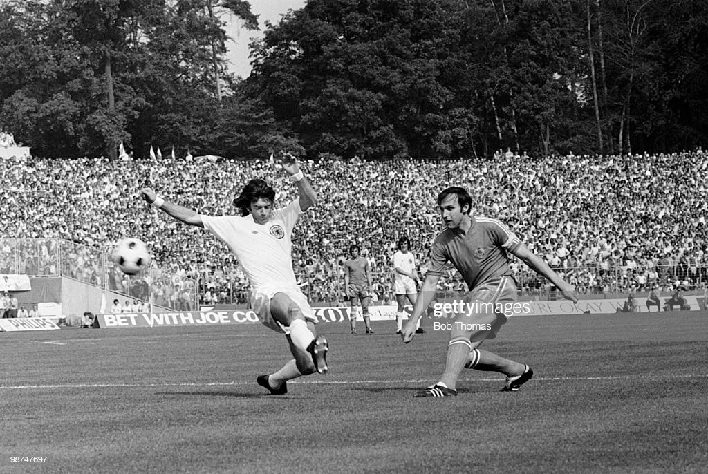Yugoslavia captain Dragan Dzajic shoots past Willie Morgan of Scotland (left) during their World Cup match at the Waldstadion in Frankfurt, 22nd June 1974. The match ended in a 1-1 draw.