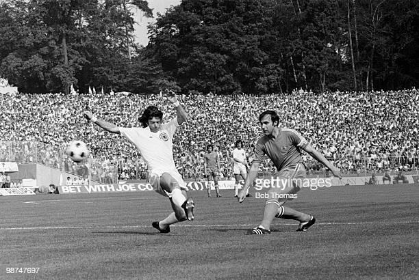 Yugoslavia captain Dragan Dzajic shoots past Willie Morgan of Scotland during their World Cup match at the Waldstadion in Frankfurt 22nd June 1974...