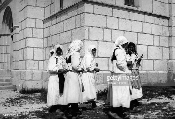 Yugoslavia kingdom Serbien Srbska Serbia : Serbian countrywomen on the way to church- undated, around 1930s- Photographer: Franz Fiedler- Published...
