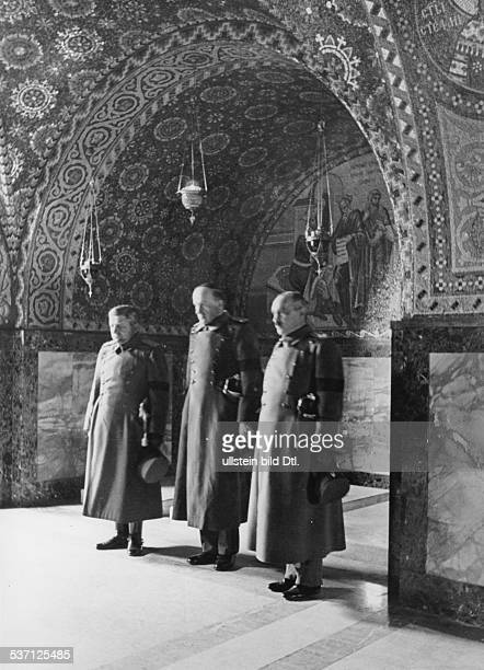 Yugoslavia kingdom Srbska Serbia Officers at the tomb of murdered King Alexander I in the crypt of the Church of St George near Topola late autumn...