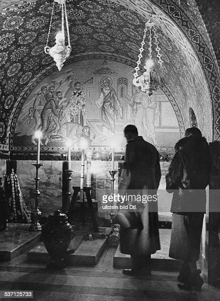Yugoslavia kingdom Srbska Serbia Visitors at the tomb of murdered King Alexander I in the crypt of the Church of St George near Topola late autumn...