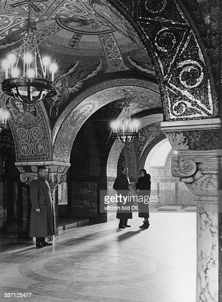 Yugoslavia kingdom Srbska Serbia Visitors in the crypt of the Church of St George near Topola burial site of the murdered King Alexander I late...