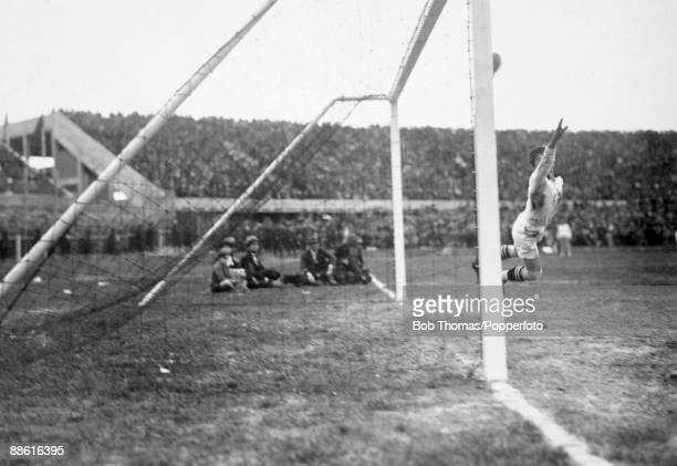 Yugoslavian goalkeeper Milovan Jaksic can't prevent Uruguay scoring one of the six goals in their emphatic 6-1 victory in the FIFA World Cup...