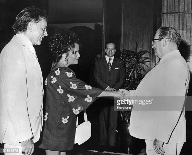 Yugoslavian President Josip Broz Tito greets films stars Elizabeth Taylor and her husband Richard Burton at his summer residence on Brioni island...