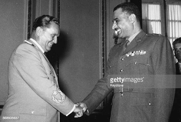 Yugoslavian President Josip Broz Tito shaking hands with his Egyptian counterpart Colonel Gamal Abdel Nasser during a state visit to Cairo December...