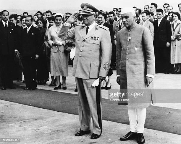Yugoslavian President Marshal Josip Broz Tito saluting as he meets Indian Prime Minister Jawaharlal Nehru at Semun Airport, Belgrade, July 2nd 1955.