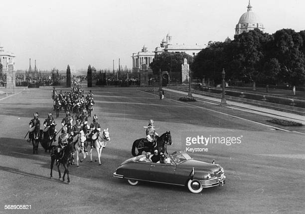 Yugoslavian President Marshal Josip Broz Tito with Indian Prime Minister Jawaharlal Nehru and President Rajendra Prasad in a car, escorted by a...