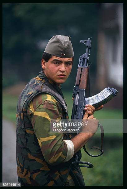 A Yugoslavian soldier holds an AK47 rifle in the village of Rajic near the Croatian town of Novska The Yugoslavian Federal Army has taken over...