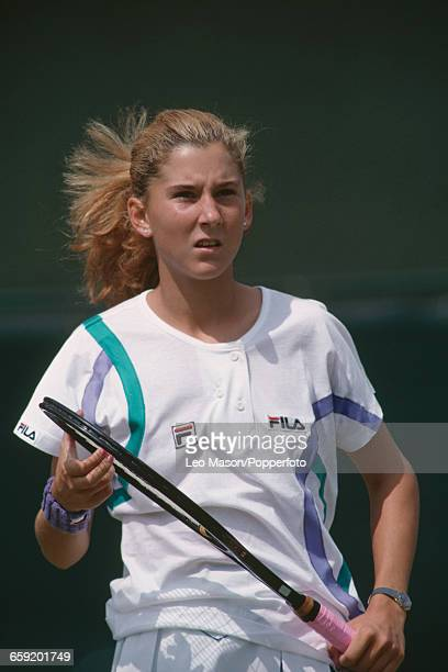 Yugoslavian tennis player Monica Seles pictured in action to reach the fourth round of the Women's Singles tournament at the Wimbledon Lawn Tennis...