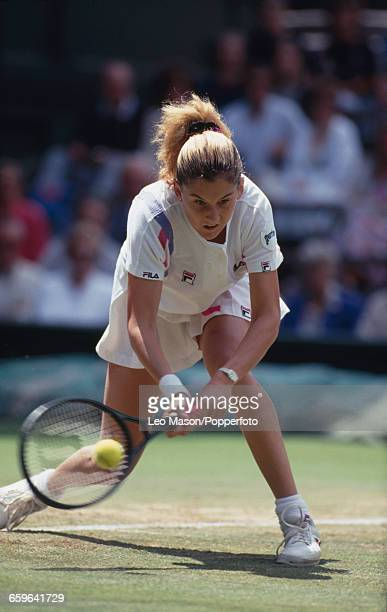 Yugoslavian tennis player Monica Seles pictured in action to reach the quarterfinals of the Women's Singles tournament at the Wimbledon Lawn Tennis...