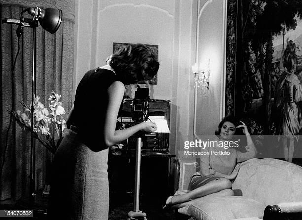 Yugoslavianborn Italian actress Sylva Koscina sitting on the sofa in her house during a photo shooting Rome June 1963