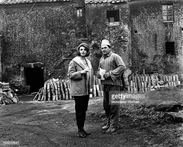 Yugoslavianborn Italian actress Sylva Koscina talking to a builder in the building site of her next new house in Castelli Romani Marino 1964