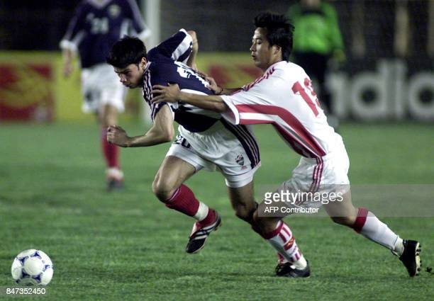 Yugoslavia's Kezman Mateja who scored the team's first goal chases the ball with China's Qi Hong during a friendly football match in Beijing 25 May...