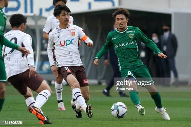 Yuhei Sato of Tokyo Verdy and Kensuke Sato of Renofa Yamaguchi compete for the ball during the J.League Meiji Yasuda J2 match between Tokyo Verdy and...