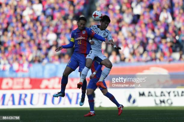Yuhei Tokunaga of FC Tokyo and Akito Takagi of Gamba Osaka compete for the ball during the JLeague J1 match between FC Tokyo and Gamba Osaka at...