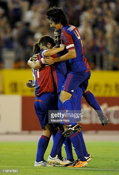 Yuhei Tokunaga of FC Tokyo celebrates his goal with teammates during the JLeague 2 match between FC Tokyo and Roasso Kumamoto at the National Stadium...