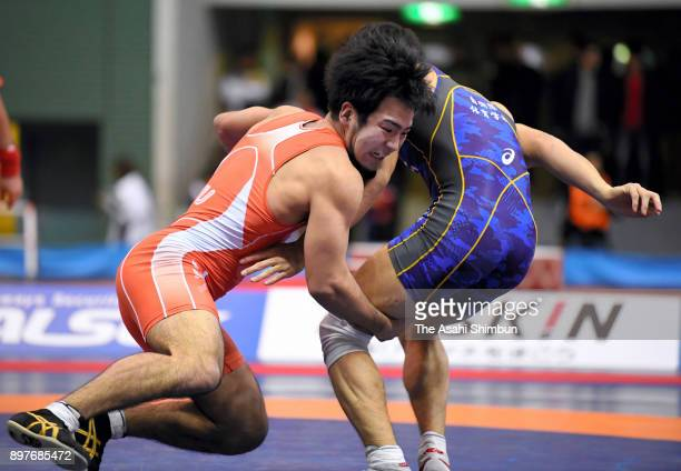 Yuhi Fujinami and Ken Hosaka compete in the Men's Freestyle 74kg final against during day three of the All Japan Wrestling Championships at Komazawa...