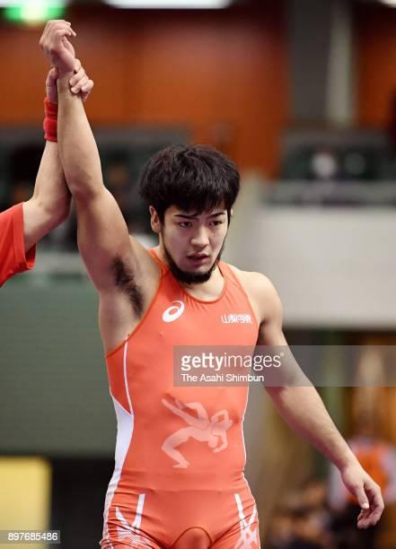 Yuhi Fujinami celebrates winning the Men's Freestyle 74kg final against Ken Hosaka during day three of the All Japan Wrestling Championships at...