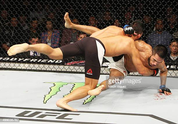Yui Chul Nam of South Korea goes for a takedown on Mike De La Torre of the United States of America in their featherweight bout during the UFC Fight...
