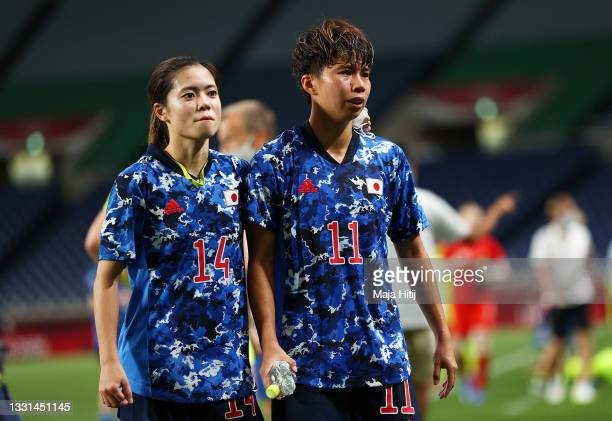 Yui Hasegawa and Mina Tanaka of Team Japan look dejected following defeat in the Women's Quarter Final match between Sweden and Japan on day seven of...