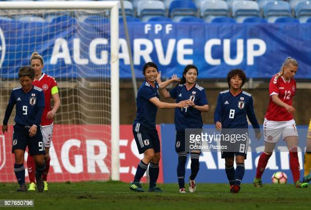 Yui Hasegawa celebrates with teammates after scores the first goal during the Women's Algarve Cup Tournament match between Denmark and Japan at...