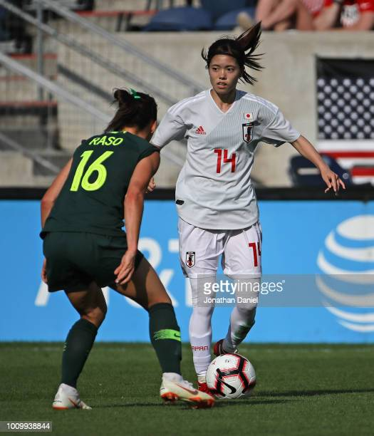 Yui Hasegawa of Japan advances the ball against Hayley Raso of Australia during the 2018 Tournament Of Nations at Toyota Park on August 2 2018 in...