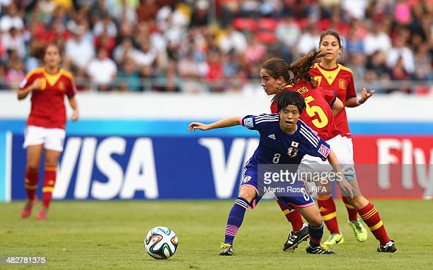 Yui Hasegawa of Japan and Rocio Galvez of Spain battle for the ball during the FIFA U17 Women's World Cup 2014 final match between Japan and Spain at...