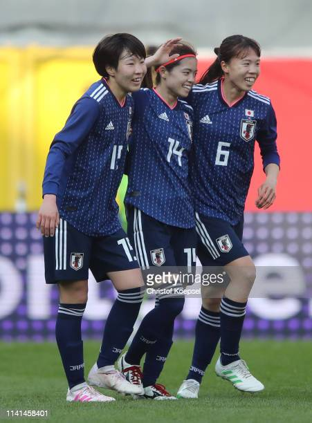 Yui Hasegawa of Japan celebrates after scoring her team's first goal with Jun Endo and Hina Sugita during the Women's International Friendly between...