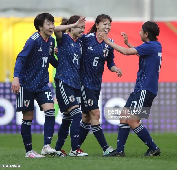 Yui Hasegawa of Japan celebrates after scoring her team's first goal with Jun Endo Hina Sugita and Narumi Miura during the Women's International...