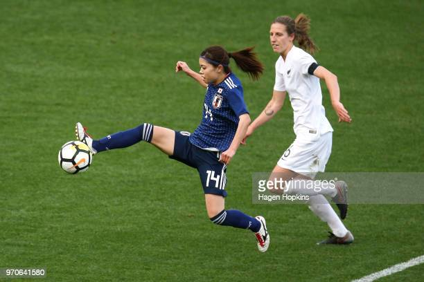 Yui Hasegawa of Japan controls the ball under pressure from Rebekah Stott of New Zealand during the International Friendly match between the New...