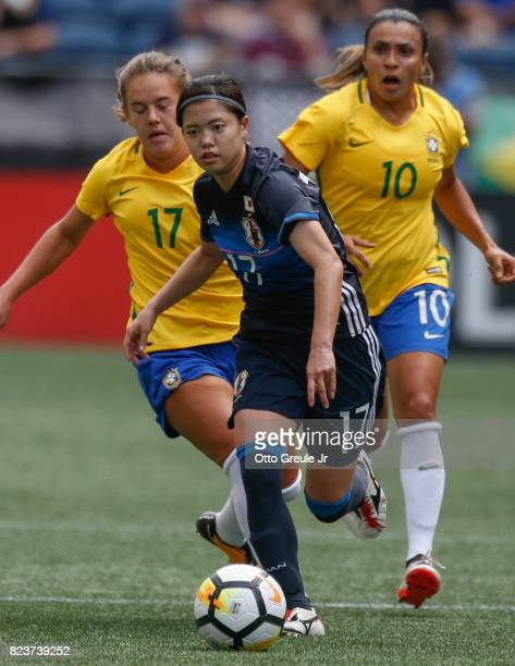 Yui Hasegawa of Japan dribbles against Andressinha and Marta of Brazil during the 2017 Tournament of Nations at CenturyLink Field on July 27 2017 in...